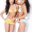 Two smiling girls in swimsuits — Stock Photo