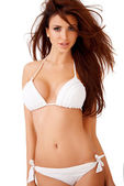 Sexy curvy brunette in a white bikini — Stock Photo