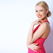 Lovely blond woman smiling while posing on white — Stock Photo