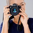 Female photographer taking a photo — Stock Photo