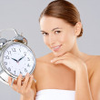 Woman holding an alarm clock — Stock Photo #31819149