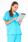 Doctor checking information on a tablet — Stock Photo