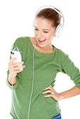 Woman laughing as she enjoys her music — Stock Photo