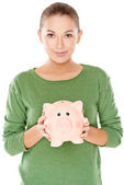 Woman with her piggy bank — Stock Photo