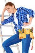 Young DIY handy woman with a problem — Stock Photo