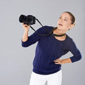 Pretty vivacious young female phoptographer — Stock Photo