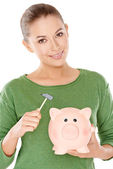 Woman contemplating opening her piggy bank — Stockfoto