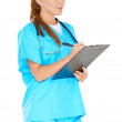Pretty young nurse writing up notes — Stock Photo