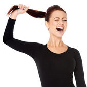 Woman fed up with long hair screaming — Stock Photo