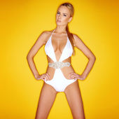 Beautiful shapely woman in a white swimsuit — Stock Photo