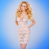 Glamorous young blond in a see-through dress — Stock Photo