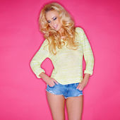 Glamorous blond in trendy skimpy denim shorts — Stock Photo