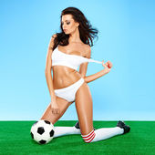 Sensual gorgeous brunette soccer player — Stock Photo