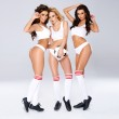 Three gorgeous sexy lady soccer players — Stock Photo #44846185