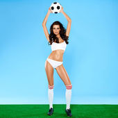 Beautiful busty woman soccer player in lingerie — Stock Photo