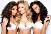 Three beautiful sexy curvaceous young women — Stock Photo