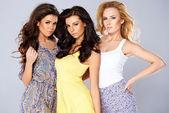 Beautiful seductive trio of young women — Stock Photo