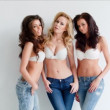 Young women in jeans and bras — Stock Video #45849559