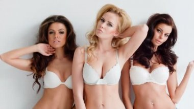 Young women wearing white lingerie — Stock Video