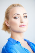 Haughty beautiful young blond woman — Stock Photo