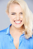 Beautiful blond woman gnashing her teeth — Stock Photo