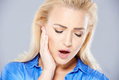 Young woman suffering from toothache — Stock Photo