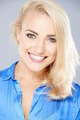 Beautiful happy blond woman with a joyful smile — Stock Photo