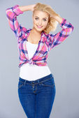 Sexy curvaceous young blond woman — Stock Photo