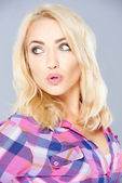Sexy blond pouting her lips in admiration — Stock Photo