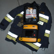 Ade defibrillator on the firefighter's jacket — Stock Photo