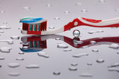 Red-white toothbrush — Stock Photo
