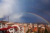 Beautiful double rainbow in dark blue sky — Stock Photo