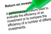 Highlighted word performance for Return on investment, green pen — Stock Photo