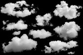 Set of isolated clouds over black. — Zdjęcie stockowe