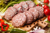Raw meatball on a chopping board and ingredients. horizontal. cl — Stock Photo