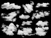 Set of isolated clouds over black. — Stock Photo