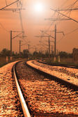 Curved railroad in sunset — Stock Photo