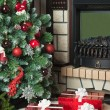 Christmas tree, fireplace and a red gift boxes — Stock Photo