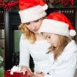 Girl and mother in Santa hats write letter to Santa — Stock Photo