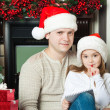 Girl and father in Santa hats write letter to Santa — Stock Photo