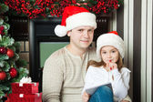 Girl and father in Santa hats write letter to Santa — Стоковое фото