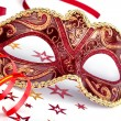 Red carnival mask with confetti and streamer — Stock Photo