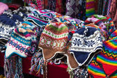 Many multicolored knitted hats — Stock Photo