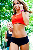 Running in city park. Woman runner outside jogging — Stock Photo