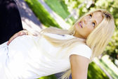 Pregnant woman relaxing in the park — Stock Photo