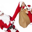 Santa Claus with beautifull girl wearing santa clothes — Stock Photo #34876451
