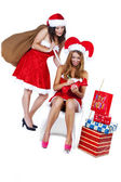 Beautiful friends wearing santa claus clothes, gifts — Stock Photo