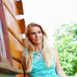 Foto Stock: Beautiful blond woman outdoorlying