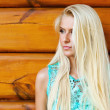Stock Photo: Beautiful blond woman outdoorlying