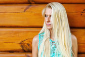 Beautiful blond woman outdoorlying — Stock Photo